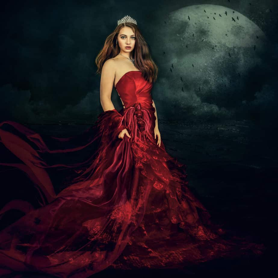 Conceptual photography, femaile in a red dress under the moon.